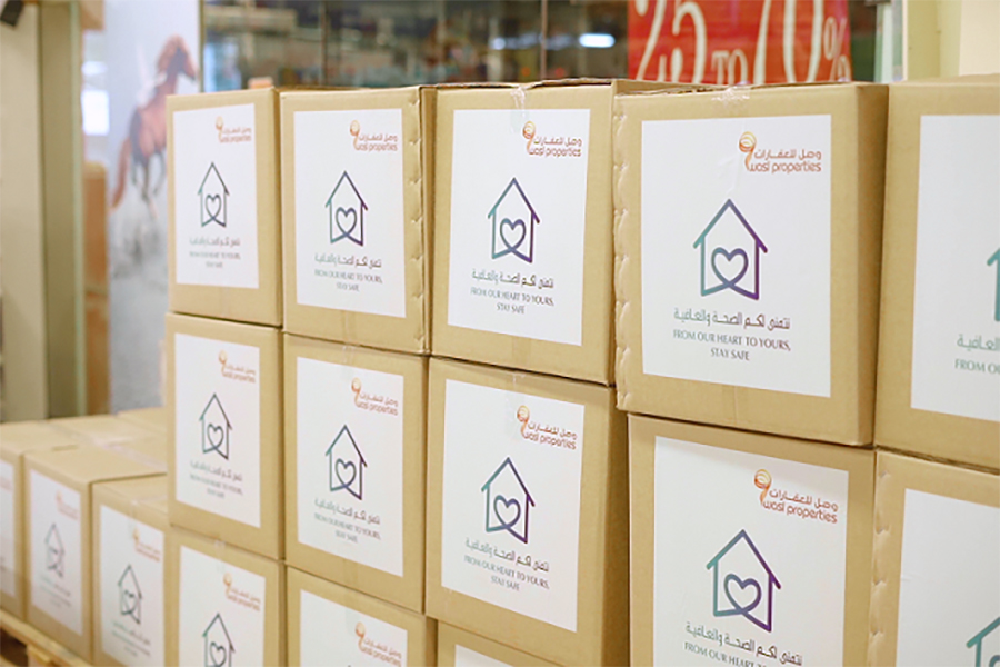 wasl Properties distributes food boxes in Naif, Al Ras